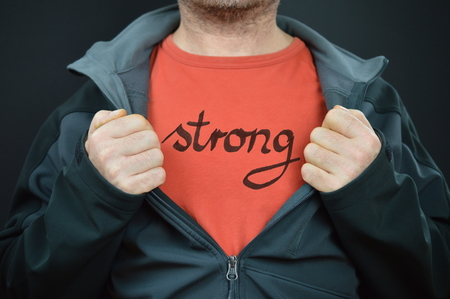 a man with the word strong on his t-shirt