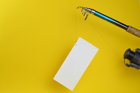 temptation, a blank piece of paper at the fishhook Stock Photo