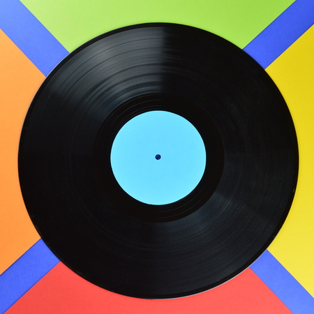 Old black vinyl record with blank black label on a black background Stock Photo