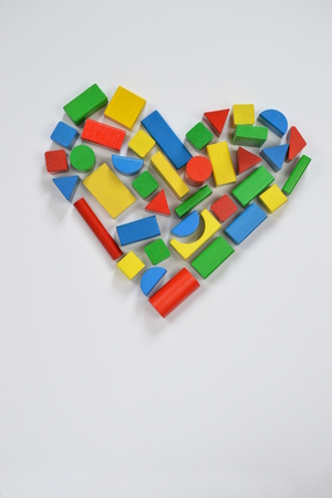 grub: Colorful wooden toy blocks shaping the form of a heart