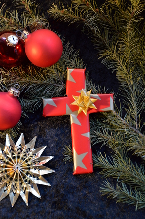 cross ornaments in fancy paper between fig branches and X-mas ornaments as a present at Christmas day