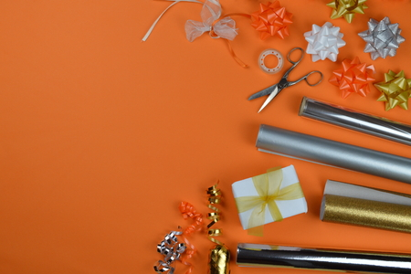 gift wrapping items for birthday presents on orange ground