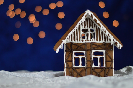home made gingerbread house with bokeh sky out of blue velvet and christmaslights