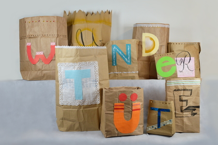big surprise bag with german lettering WUNDERT?TE on it, which means surprise bag