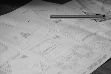 Blueprint for a church building on paper with triangle ruler fictional without a client