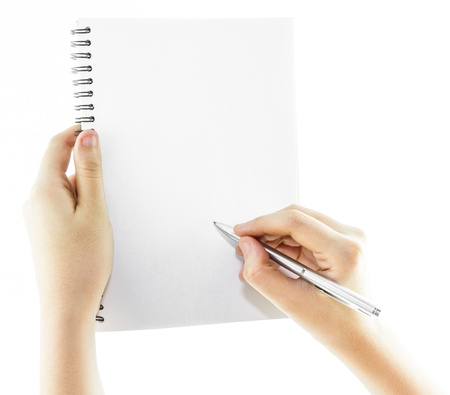Blank notebook with hand holding a pen isolate on white background photo