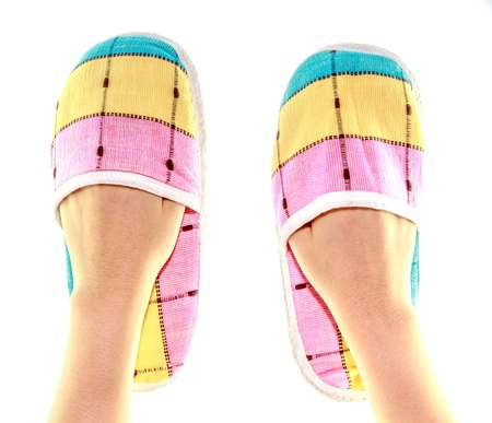 footware: colorfull slippers on hand isolate on white background