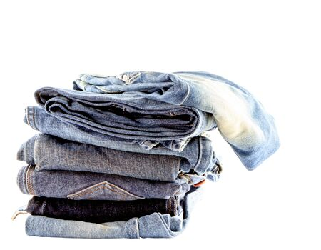 Stack of  jeans isolate on white background photo
