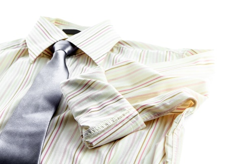 man s shirt and tie on white background photo