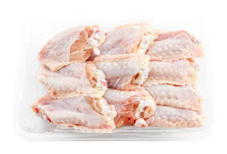 chicken wings: fresh Chicken middle wings in package isolate