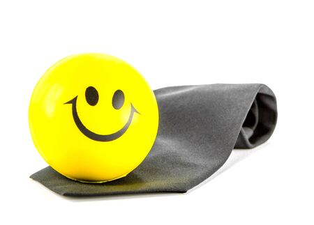 Smile ball on black necktie on white background photo