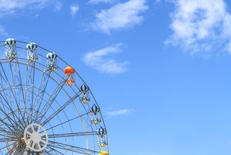 Ferris wheel with blue sky photo