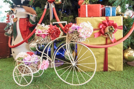 Mini intage Bicycle with flower and gift photo