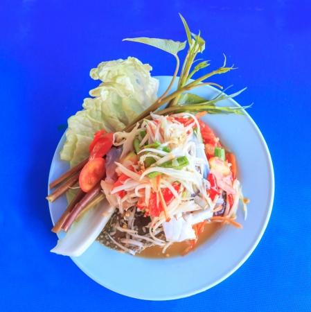 Thai papaya spicy salad or Som Tum with blue crab photo