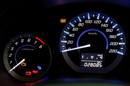 Modern car speedometer  and illuminated dashboard photo