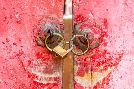 Red old door knocker with lock photo