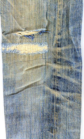 old used jeans on whita background photo
