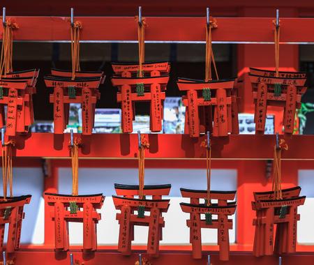 Small torii in Fushimi Inari Shrine, Kyoto, Japan photo