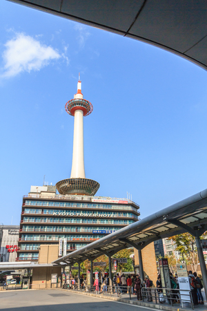 KYOTO, JAPAN - OCT 30  Kyoto Tower and Kyoto Tower Hotel viewed from Kyoto station bus terminal on 30 October 2013 The tower was first opened to the public on December 28, 1964
