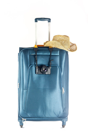 travelling baggage with camera and straw hat photo