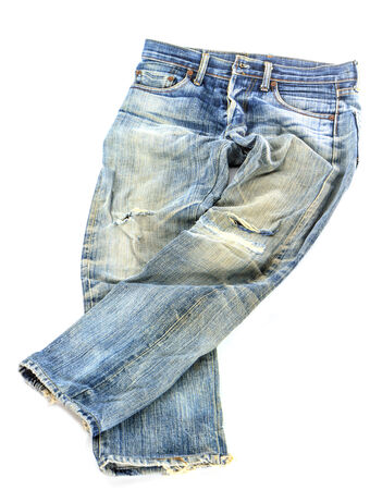 old used jeans trousers isolated on white background photo