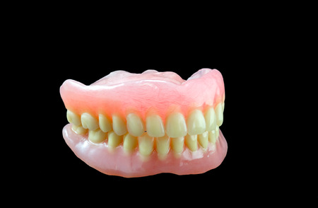 Full denture on black  photo
