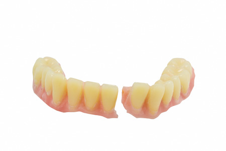 Broken denture Stock Photo