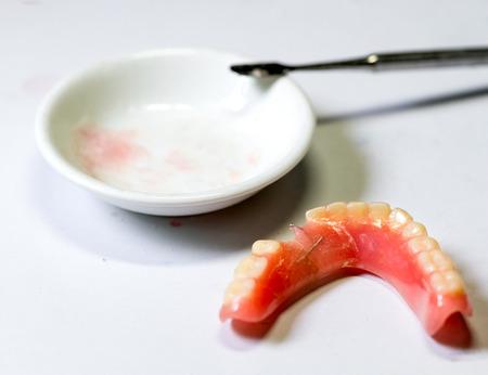 Repair broken denture Stock Photo