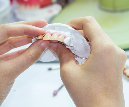 Woman hand Make denture with tool