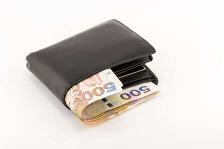 Hong Kong currency and wallet on white background photo