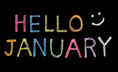 the january: Hola enero escrito en la pizarra Foto de archivo