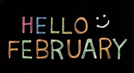 Hello February written on blackboard