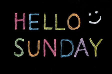 Hello Sunday written on blackboard Stock Photo