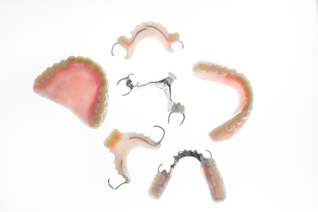 Set of denture on white background