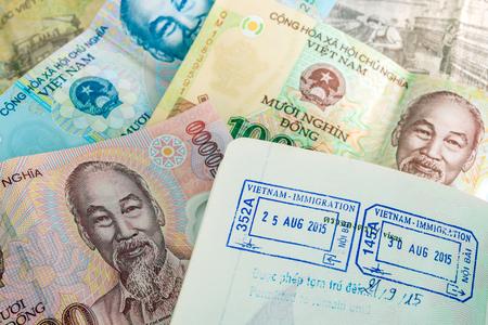 dong: Visa passport stamp from vietnam and Vietnamese money (Dong)