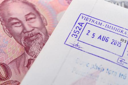 passport stamp: Visa passport stamp from vietnam and Vietnamese money (Dong)