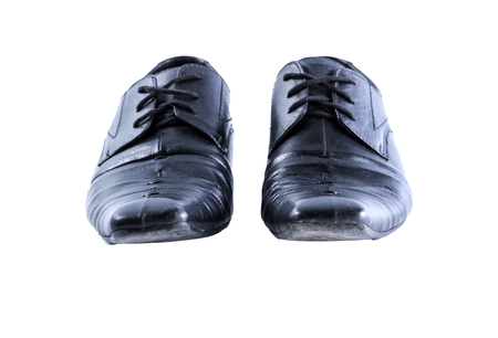 dirty feet: Used men shoes Stock Photo