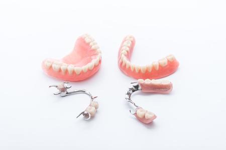 Set of dentures on white background