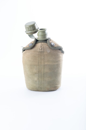 plastic soldier: Military canteen on white background Stock Photo