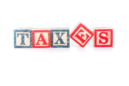 and spelling: photo of a alphabet blocks spelling TAXES isolate on white background Stock Photo