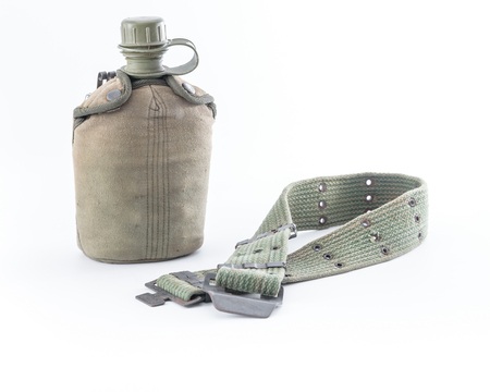 green plastic soldiers: Military canteen and army belt on white background