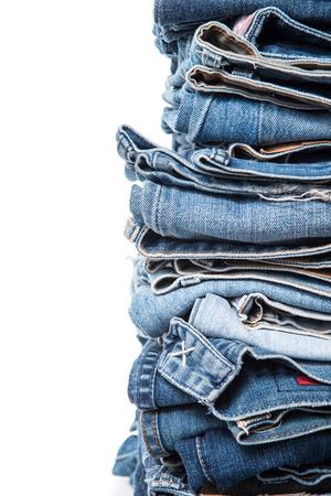 slacks: stack of jeans on white background