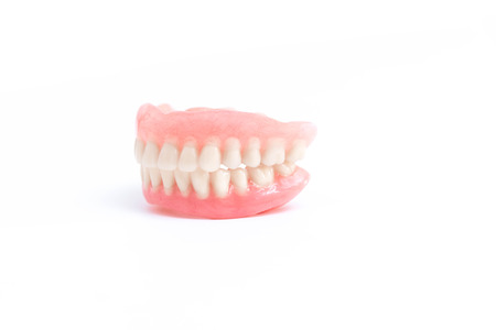 surrogate: Full dentures on white background