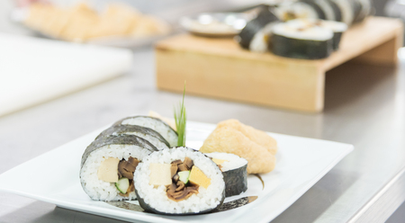 Set of tasty sushi maki roll in kitchen