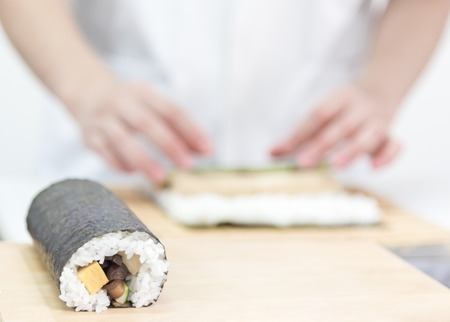 Chef Row of delicious sushi Maki roll ,Japanese food Stock Photo