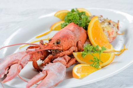 Cheese baked lobster in white plate photo
