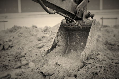 digging: Backhoe Digging And are constructed Stock Photo