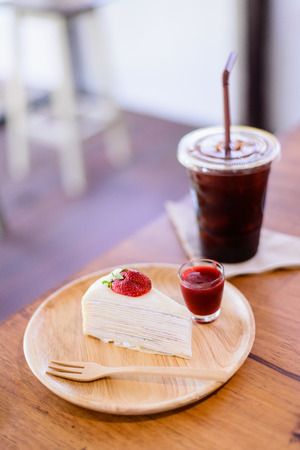 Crepes Strawberry Cake with coffee photo