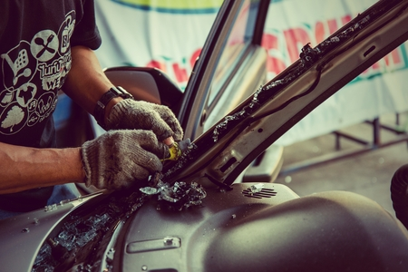 window repair: It is clear glass repair or auto accident on the road.