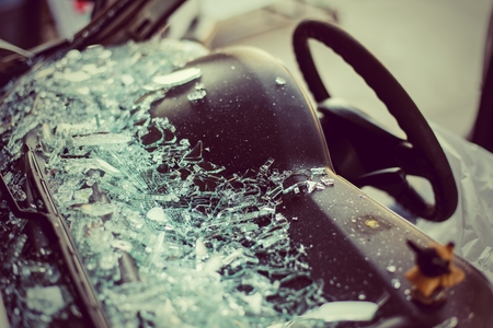 damaged: It is clear glass repair or auto accident on the road.